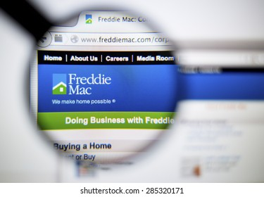LISBON, PORTUGAL - June 6, 2015: Photo of: www.freddiemac.com, Freddie Mac homepage on a monitor screen through a magnifying glass.
