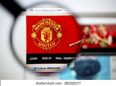 LISBON, PORTUGAL - June 6, 2015: Photo of: www.manutd.com, Manchester United  homepage on a monitor screen through a magnifying glass.