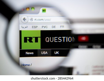 LISBON, PORTUGAL - June 6, 2015: Photo of: rt.com, RT homepage on a monitor screen through a magnifying glass.