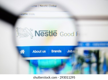LISBON, PORTUGAL - June 6, 2015. Photo of Nestle homepage on a monitor screen through a magnifying glass.