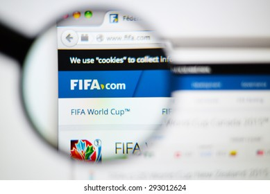 LISBON, PORTUGAL - June 6, 2015. Photo of FIFA homepage on a monitor screen through a magnifying glass.