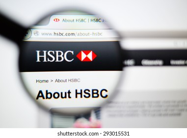 LISBON, PORTUGAL - June 6, 2015. Photo of HSBC  homepage on a monitor screen through a magnifying glass.
