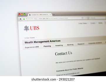 LISBON, PORTUGAL - June 6, 2015. Photo of UBS homepage on a monitor screen through a magnifying glass.