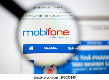 LISBON, PORTUGAL - June 6, 2015. Photo of Mobifone homepage on a monitor screen through a magnifying glass.