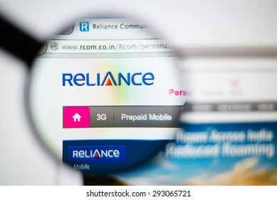 LISBON, PORTUGAL - June 6, 2015. Photo of Reliance Communications homepage on a monitor screen through a magnifying glass.
