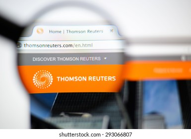LISBON, PORTUGAL - June 6, 2015. Photo of Thomson Reuters homepage on a monitor screen through a magnifying glass.