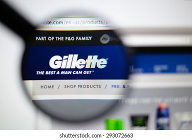 LISBON, PORTUGAL - June 6, 2015. Photo of Gillette homepage on a monitor screen through a magnifying glass.