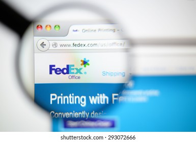 LISBON, PORTUGAL - June 6, 2015. Photo of FedEx homepage on a monitor screen through a magnifying glass.