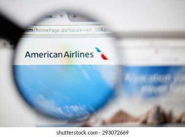 LISBON, PORTUGAL - June 6, 2015. Photo of American Airlines homepage on a monitor screen through a magnifying glass.