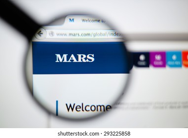LISBON, PORTUGAL - June 6, 2015. Photo of Mars homepage on a monitor screen through a magnifying glass.