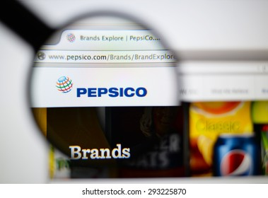 LISBON, PORTUGAL - June 6, 2015. Photo of PepsiCo homepage on a monitor screen through a magnifying glass.