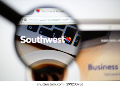 LISBON, PORTUGAL - June 6, 2015. Photo of Southwest Airlines homepage on a monitor screen through a magnifying glass.