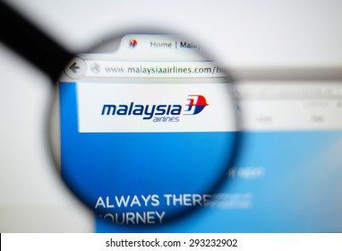 LISBON, PORTUGAL - June 6, 2015. Photo of Malaysia Airlines homepage on a monitor screen through a magnifying glass.
