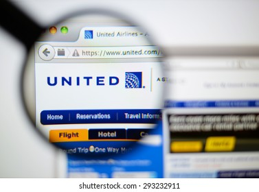 LISBON, PORTUGAL - June 6, 2015. Photo of United Airlines homepage on a monitor screen through a magnifying glass.