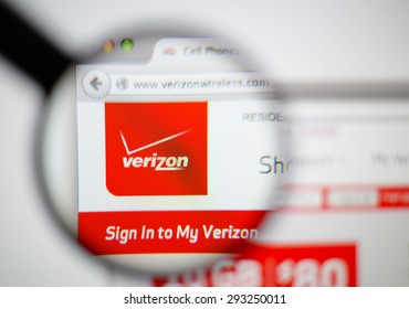 LISBON, PORTUGAL - June 6, 2015. Photo of Verizon homepage on a monitor screen through a magnifying glass.
