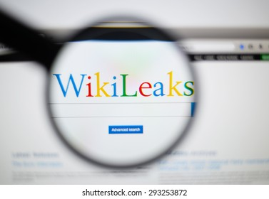 LISBON, PORTUGAL - June 6, 2015. Photo of WikiLeaks homepage on a monitor screen through a magnifying glass.