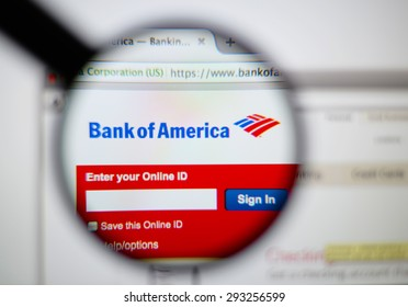 LISBON, PORTUGAL - June 6, 2015. Photo of Bank of America homepage on a monitor screen through a magnifying glass.