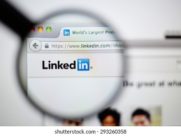 LISBON, PORTUGAL - June 6, 2015. Photo of LinkedIn homepage on a monitor screen through a magnifying glass.