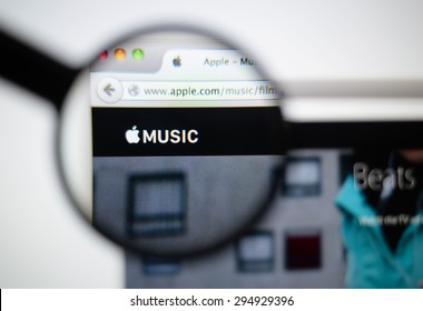 LISBON, PORTUGAL - June 6, 2015. Photo of Apple Music homepage on a monitor screen through a magnifying glass.