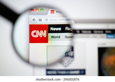 LISBON, PORTUGAL - June 6, 2015. Photo of CNN homepage on a monitor screen through a magnifying glass.