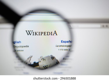LISBON, PORTUGAL - June 6, 2015. Photo of Wikipedia homepage on a monitor screen through a magnifying glass.