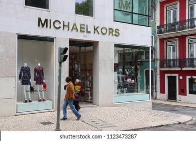 LISBON, PORTUGAL - JUNE 6, 2018: Person walks by Michael Kors fashion shop at Avenida da Liberdade (Liberty Avenue) in Lisbon. This boulevard is renowned for luxury brand shopping.