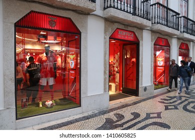 LISBON, PORTUGAL - JUNE 6, 2018: People walk by official Benfica Lisbon sports team shop in Lisbon. Lisbon is the 11th-most populous urban area in the EU (2.8 million people).