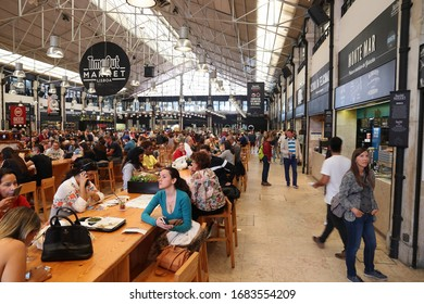 LISBON, PORTUGAL - JUNE 6, 2018: People eat at TimeOut Market in Lisbon, Portugal. TimeOut Market is a unique attempt to bring all best restaurants in Lisbon at one place.