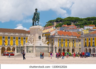 LISBON, PORTUGAL - JUNE 9, 2014: Commerce Square of Lisbon, commonly known as Terreiro do Paco in Portuguese, with monumental statue of King Jose I in the middle, and filled by visitors.
