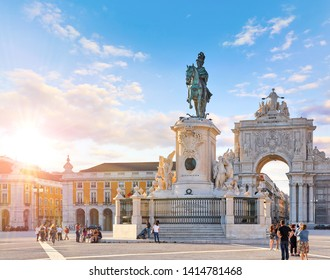 Lisbon, Portugal. King Jose I Statue at Praca do Comercio in front of Triumphal Arch near waterfront. Old town of Lisboa in historic midtown Alfama district. Evening sunset and blue sky with clouds.