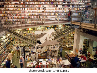 LISBON, PORTUGAL: Many old books and customers of the popular bookstore Ler Devagar with artworks and high bookshelves on 19 May, 2019. Portuguese language has 250 million speakers around the world