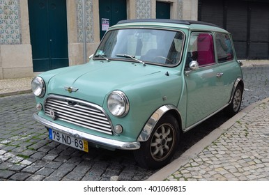 LISBON, PORTUGAL - MARCH 04, 2016:  Classic light blue Austin Mini motorcar in the streets of the Alfama district of Lisbon Portugal.