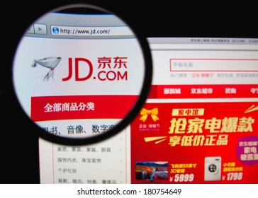 LISBON, PORTUGAL - MARCH 10, 2014: Photo of Jingdong Mall homepage on a monitor screen through a magnifying glass.