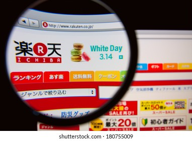 LISBON, PORTUGAL - MARCH 10, 2014: Photo of Rakuten homepage on a monitor screen through a magnifying glass.