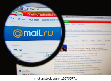 LISBON, PORTUGAL - MARCH 10, 2014: Photo of Mail.ru homepage on a monitor screen through a magnifying glass.