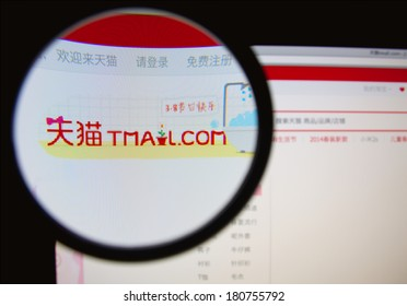 LISBON, PORTUGAL - MARCH 10, 2014: Photo of Tmall.com homepage on a monitor screen through a magnifying glass.