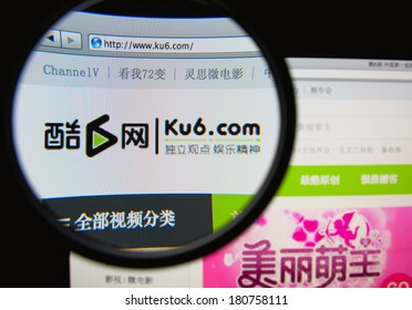 LISBON, PORTUGAL - MARCH 10, 2014: Photo of Ku6 Media homepage on a monitor screen through a magnifying glass.