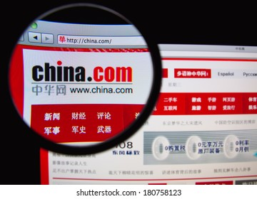 LISBON, PORTUGAL - MARCH 10, 2014: Photo of the China.com homepage on a monitor screen through a magnifying glass.