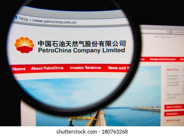 LISBON, PORTUGAL - MARCH 10, 2014: Photo of PetroChina Company Limited homepage on a monitor screen through a magnifying glass.