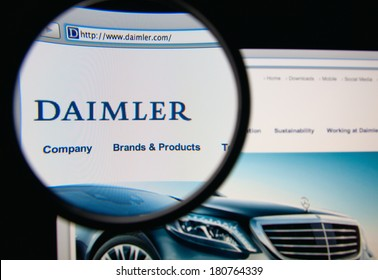 LISBON, PORTUGAL - MARCH 10, 2014: Photo of Daimler AG homepage on a monitor screen through a magnifying glass.