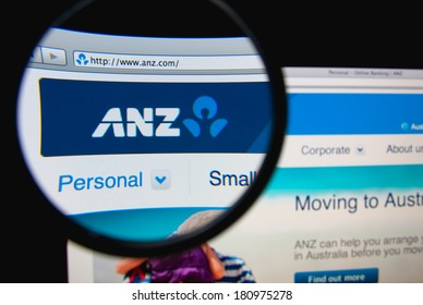 LISBON, PORTUGAL - MARCH 10, 2014: Photo of the Australia and New Zealand Banking Group Limited (ANZ) homepage on a monitor screen through a magnifying glass.
