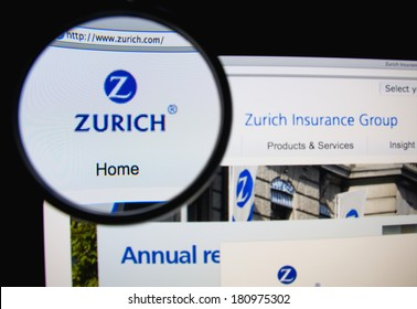 LISBON, PORTUGAL - MARCH 10, 2014: Photo of Zurich Insurance Group homepage on a monitor screen through a magnifying glass.