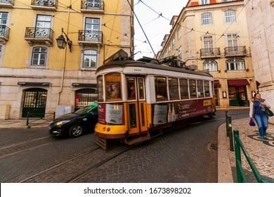 Lisbon, Portugal / March 12, 2019: A view of the incline and tram, Lisbon, Portugal. Famous touristic yellow tram in Lisbon, numer 28