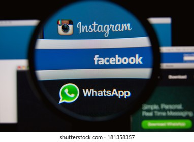 LISBON, PORTUGAL - MARCH 13, 2014: Photo of Facebook, Instagram and Whatsapp homepage on a monitor screen through a magnifying glass.  Facebook owns Instagram and Whatsapp.