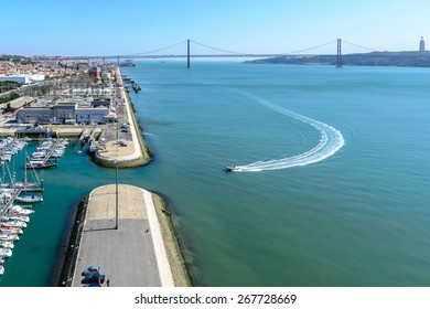 Lisbon, Portugal - March 13, 2015: View from the monument to the Discoveries on the bridge over the Tagus river  in Belem