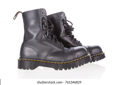 Lisbon, Portugal - March 16, 2010: Dr. Martens black leather work boots with steel toe and military style isolated on white background.