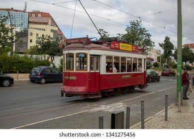 Lisbon, Portugal - March 17 201: A Yellow Bus Tram departs from Martim Moniz with passengers for a tour