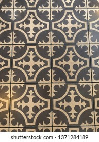 Lisbon / Portugal - March 19 2019: Grey and white tiled floor in Lisbon, Portugal