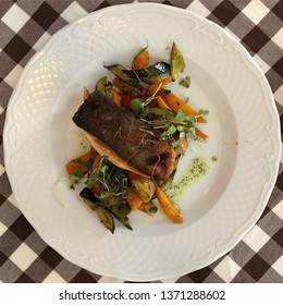 Lisbon / Portugal - March 19 2019: Cooked salmon filet with vegetables in Lisbon, Portugal