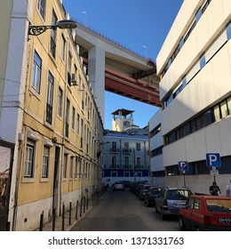 Lisbon / Portugal - March 19 2019: Low angle view of bridge over residential neighbourhood in Lisbon, Portugal
